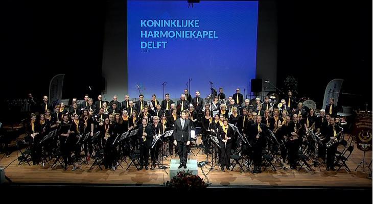 Concours in beeld: Harmoniekapel Delft speelt Kevin Houben